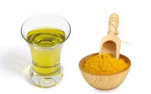 An image of turmeric powder and oil that can be used to whiten your underarms.