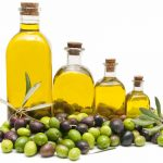 An image of olive oil in glass bottles.
