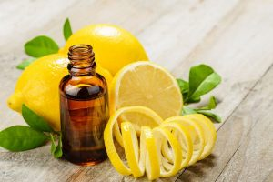 An image of lemons, lemon peel, and lemon essential oil.
