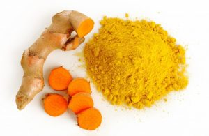An image of turmeric root and powder.